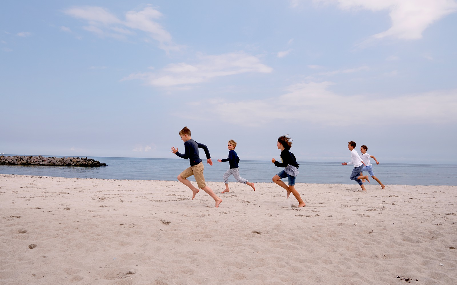 children running over the beach